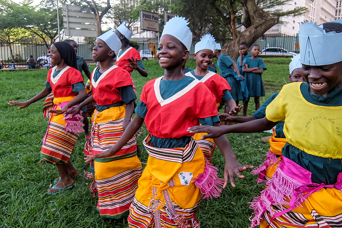 Students of Magdalene (CQ) Primary School, rehearse a traditional dance, called Bakisimba, at the National Theatre Gardens(CQ), in Kampala, Uganda during the premier of a local film, ÔThe Secrets of a TouristÕ. (Nakisanze Segawa, GPJ Uganda)